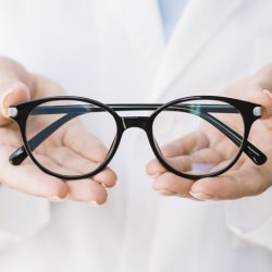 ophthalmologist-showing-pair-eyeglasses
